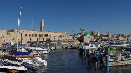 akko : Port of Acre, Israel. with boats and the old city in the background.
