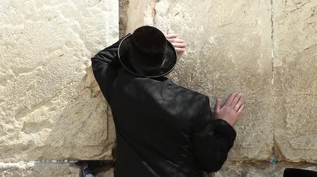 jewish prayer : An Orthodox jewish man prays by the Wailing wall, known also as The western wall, its the holiest site in Judaism and the place to which Jews turn for prayer.