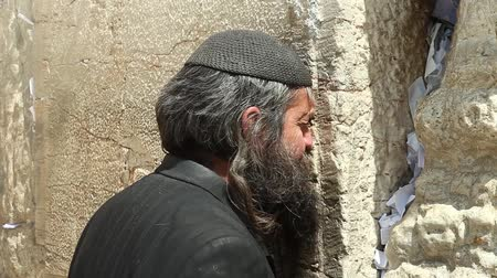 wailing : An Orthodox jewish man prays by the Wailing wall, known also as The western wall, its the holiest site in Judaism and the place to which Jews turn for prayer.