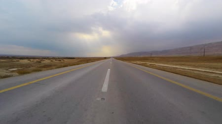 asphalt road : Empty Desert road - driving footage Stock Footage