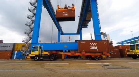 yards : International Container ship unloading containers on service trucks at Haifas international port. Stock Footage