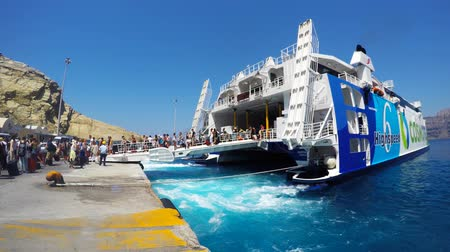 aegean sea : Tourists arriving and boarding the Santorini - Ios  ferry line on board Hellenic seaways Highspeed 6 catamaran super ferry. Stock Footage