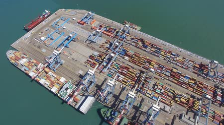 délre : Commercial port with container ship - Aerial footage