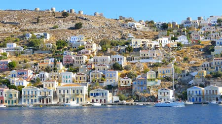 rhodes : Symi island - Colorful houses and small boats at the heart of the village Stock Footage