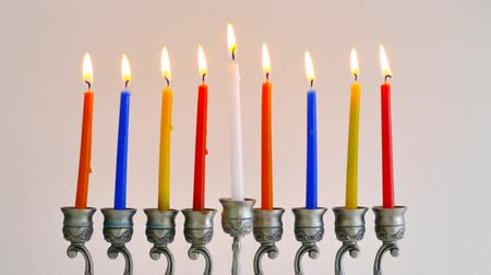 zsidó : Jewish Menorah Hanukkah candles burning Stock mozgókép