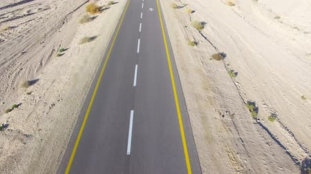 straight road : Empty desert road - Aerial footage Stock Footage