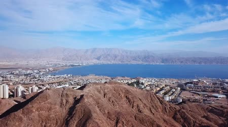 jewish : Eilat, Israel - Aerial footage over Solomons mountains, revealing Eilats skyline and the red sea