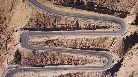 cikkcakk : Desert road - Aerial footage of traffic going up and down a  serpentine mountain road