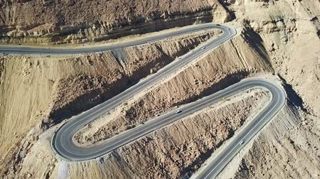yemen : Desert road - Aerial footage of traffic going up and down a  serpentine mountain road