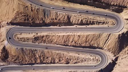 yemen : Time lapse Desert road - Aerial footage of traffic going up and down a  serpentine mountain road