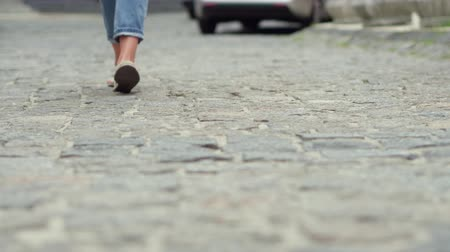cobbles : View of girls legs pacing on cobbles.