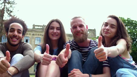 latinamerican : Cheerful students showing thumbs up. Stock Footage