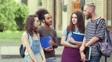 latinamerican : College friends standing talking before university classes. Stock Footage