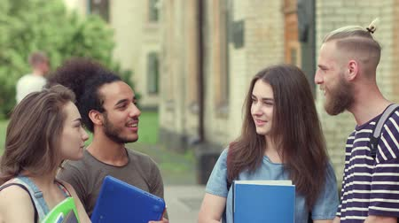 latinamerican : Young students standing in campus, communicating. Stock Footage