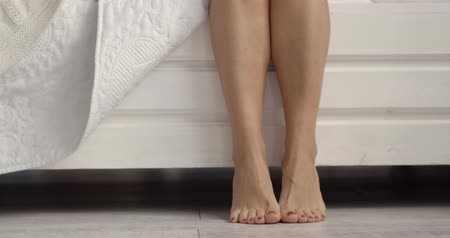 тапочка : Beautiful legs of woman. Getting up in the morning.