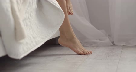 sandali : Half length image of woman s legs. Morning concept.