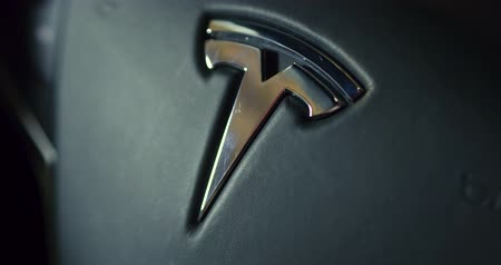 tesla car : Close up of Tesla car logo on steering wheel. Model X.