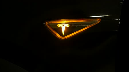 tesla car : Turn signal with brand logo. Tesla car concept.