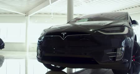tesla car : Tesla car Model X on car show. Front side. Black color.. Electric cars show room E-Drive. Kiev, Ukraine 13 february 2018.