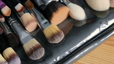 whitebackground : Close up of professional make up brushes collection. Beauty concept. Stock Footage