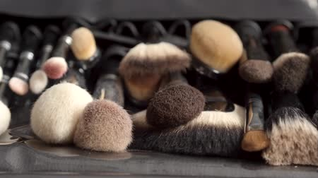 aplikatör : Soft professional brushes for make up on table. Beauty concept. Stok Video
