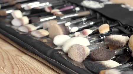 aplikatör : Side view image of professional makeup tools on wooden background. Beauty concept.