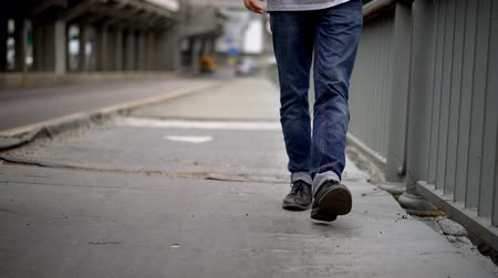 cisne : Bridge Pavements. Walking Man. Selective Focus On Legs. Solo Walking Concept.