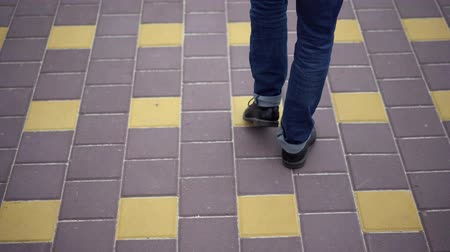 tcheco : Young Man Walking On Bridge Pavement. Walking Alone. Selective Focus On Legs. Stock Footage