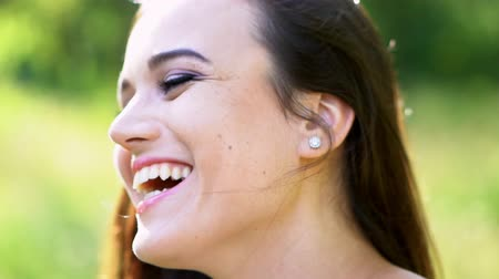 model s : Lovely Brown-Haired Woman Broadly Smiles And Turn To Look At Camera. Close-Up Of Beautiful Woman s Face With Light Daily Makeup. Side View Of Sweet Woman s Face And Her Pierced Ear With A Silver Earing.