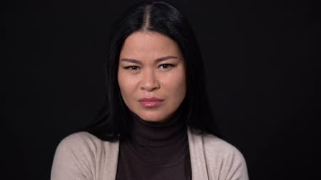 smelly : Pretty Asian Woman Saw Something Disgusting. Close Up Of Attractive Woman Wrinkling Her Nose In Disgust. Stock Footage