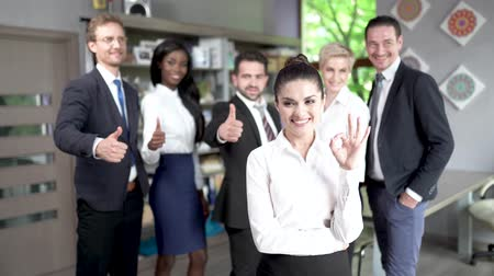 businesspeople : Business People Making Photo After Conference. Standing Middle Office. Young Woman With Ok Sign Standing Before.