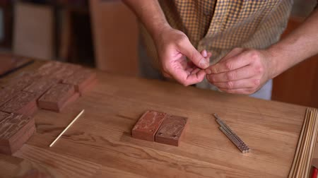 itens : Carpenter Working In Old Workshop. Going To Make Wooden Ship Figures From Items. Selective Focus On Hands.