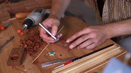 itens : Carpenter Making Pattern On Wooden Items For Small Ships Figures In Old Workshop. Selective Focus On Hands.