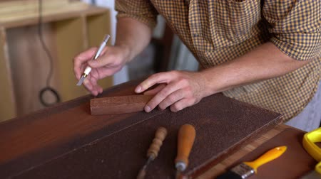traditional instruments : Craftsmans Hands Holding A Chisel Carving Wood. Closeup. Carving Wood. Selective Shop