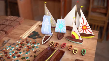 model s : Charming Wooden Boats Stands On The Carpenter s Table. Wooden Pieces Of Small Toy Wooden Boats Laying On The Table. Selective Shot