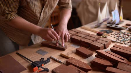 traditional instruments : Charming Joiner At Work Carving Wooden Toys. Hands Of Skilled Carpenter Holding Chisel While Carving Wood Boat. Selective Shot Stock Footage