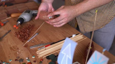 cola : Joiners Hands Gluing A Blue Star To The Wooden Plank. Decorating Wooden Toy Boat. Closeup Vídeos