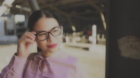 lépcsőház : Beautiful Face Of Asian Businesswoman Walking In City Street. Touching Glasses And Looking Aside. Wearing Elegant Blouse.