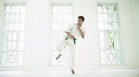 struggling : Physically Strong Male In White Big Gym. Standing In Defense Position While Training Martial Arts. Sport Concept.