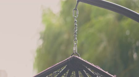 zámotek : The Hammock Is Hanging On The Chain In The Cafe In The Beautiful Park.The Slight Wind Is Blowing . Dostupné videozáznamy