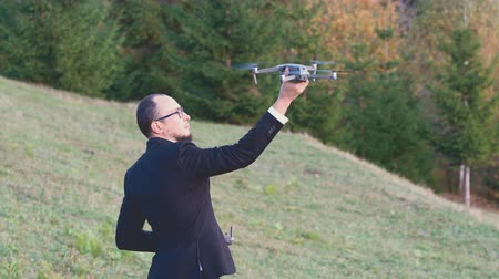 A Man With Glasses Holds His Drone. The Gadget Is In The Hands Of A Businessman. Drone Operator Concept