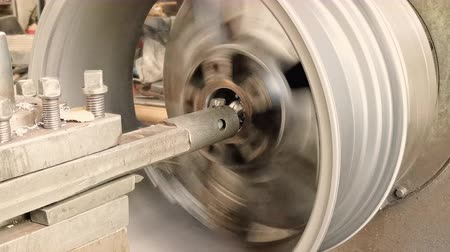 balanceamento : The Process Of The Cutting Rim Center Bore From The Small Diameter To The Bigger One. Close-up Shot Stock Footage