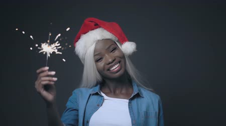 African Young Woman With White Hair Like Santa Claus Showing sparkler. Hair Beauty Concept. Vídeos