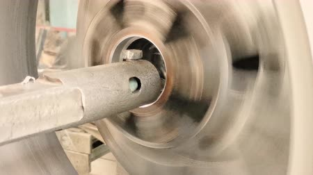 aro : The Process Of The Cutting Of The Rim Center Bore From The Small Diameter To The Bigger One. The Formation Of Steel Cuttings. Close-up Shot Stock Footage