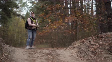 atmak : Woman And Her German Shepherd Dog Are In The Autumn Wood. They Are Training A Command - To Catch And To Bring A Stick Back.