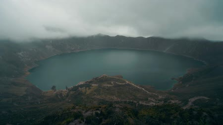kolaps : Zoom out time lapse over the Quilotoa crater in Ecuador.The 3 kilometers wide caldera was formed by the collapse of the volcano following a catastrophic eruption about 800 years ago.