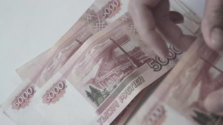 feixes : Rouble. Money. Bill 5000. Counting money.