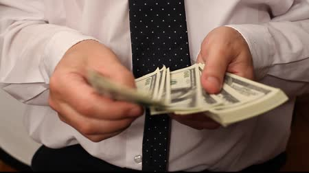 clothing : Businessman counting the money Stock Footage