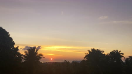 tarkabarka : accelerated video of sunset, sunrise in jungle. rainbow on the horizonte. time lapse clouds Change sky