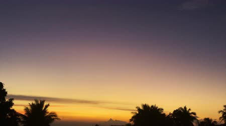 gamma : accelerated video of sunset, sunrise in jungle. rainbow on the horizonte. time lapse clouds Change sky
